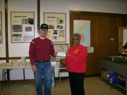 Lowe May prsents check to Junction City Food Pantry