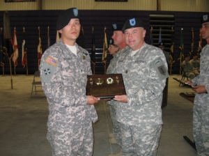 SGT Brewer accepts his honor for the Warrior Leader Course